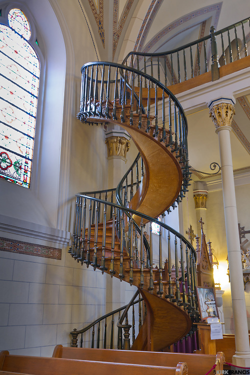 The staircase has two 360 degree turns and no visible means of support. Also, it is said that the staircase was built without nails--only wooden pegs. Questions also surround the number of stair risers relative to the height of the choir loft and about the types of wood and other materials used in the stairway's construction.