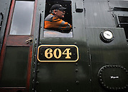 ©London News pictures. 30/03/2011. The driver of the diesel shunter carefully moves the locomotive. The King Edward II steam locomotive is moved from her protective shed at the Railway Centre in Oxfordshire, England, on 30th March 2011, ahead of her public unveiling this weekend. A small group of volunteer workers met every two weeks and completed the restoration of the engine, once destined for the scrap heap, after 20 years. King Edward II is a Great Western Railway (GWR) heavy express steam locomotive, one of only three surviving members of this class of locomotive. King Edward II performed over 1,500,000 miles of service pulling trains between London Paddington and the West of England, and also in latter years between Paddington and South Wales or Wolverhampton. Introduced in the 1920s for taking express trains over the steep gradients (banks) of South Devon, the Kings were withdrawn in the early 1960s as diesel locomotives replaced them. 6023 spent many years rotting at Barry Scrapyard, and had her rear driving wheels cut through with an oxy-acetylene torch after a shunting accident. . Picture credit should read Stephen Simpson/LNP