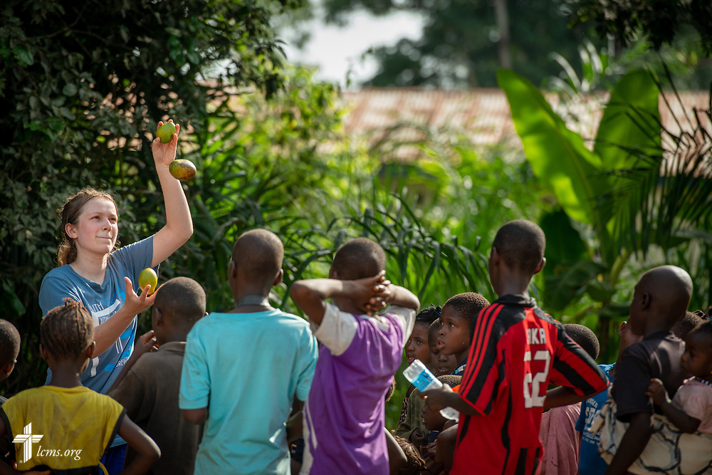 Hayden Rensner, a student at Concordia University, Nebraska, juggles mangoes for children following the fourth day of the LCMS Mercy Medical Team on Thursday, May 10, 2018, in the Yardu village outside Koidu, Sierra Leone, West Africa. LCMS Communications/Erik M. Lunsford