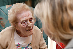Woman talking to a care assistant,