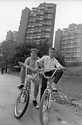 Kids on Bikes near Tower Blocks, UK, 1980s.