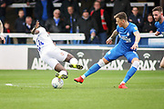 Peterborough Utd midfielder Ben White (6) stops Coventry City forward Bright Enobakhare (24) during the EFL Sky Bet League 1 match between Peterborough United and Coventry City at London Road, Peterborough, England on 16 March 2019.