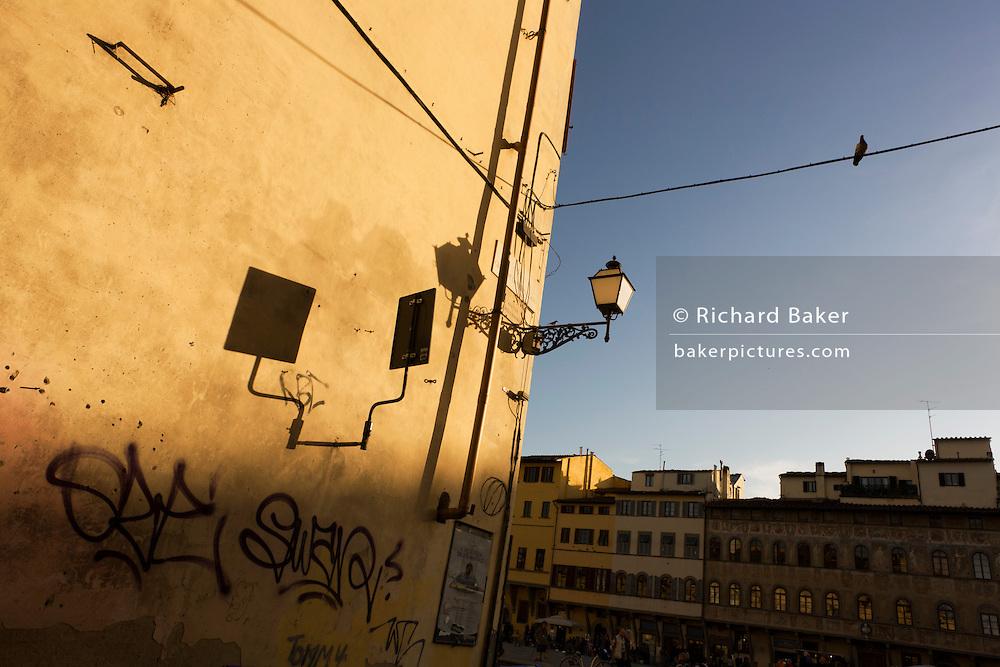 Graffiti street corner on Florence's Piazza Santa Croce.
