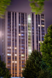 © Licensed to London News Pictures. 25/06/2017. London, UK. Lights on in widows of the Taplow block on the Chalcots estate in Swiss Cottage, Camden, showing residents who have refused to leave. Residents have been asked to leave their apartments on the north london estate after government tests found cladding on the building were flammable, making the buildings unsafe. Photo credit: Andre Camara/LNP