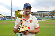 Sir Alastair Cook of Essex pose with the County Championship trophy during the Specsavers County Champ Div 1 match between Somerset County Cricket Club and Essex County Cricket Club at the Cooper Associates County Ground, Taunton, United Kingdom on 26 September 2019.