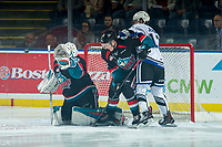 KELOWNA, CANADA - OCTOBER 5:  D-Jay Jerome #12 of the Victoria Royals is checked by Lassi Thomson #2 as James Porter #1 of the Kelowna Rockets makes a glove save during second period on October 5, 2018 at Prospera Place in Kelowna, British Columbia, Canada.  (Photo by Marissa Baecker/Shoot the Breeze)  *** Local Caption ***