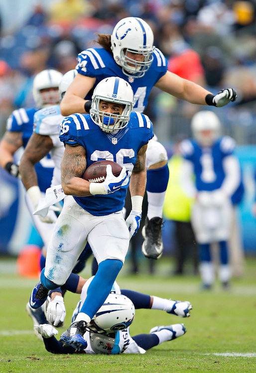 NASHVILLE, TN - DECEMBER 28:  Daniel Herron #36 of the Indianapolis Colts runs the ball in the first quarter of a game against the Tennessee Titans at LP Field on December 28, 2014 in Nashville, Tennessee.  The Colts defeated the Titans 27-10.  (Photo by Wesley Hitt/Getty Images) *** Local Caption *** Daniel Herron