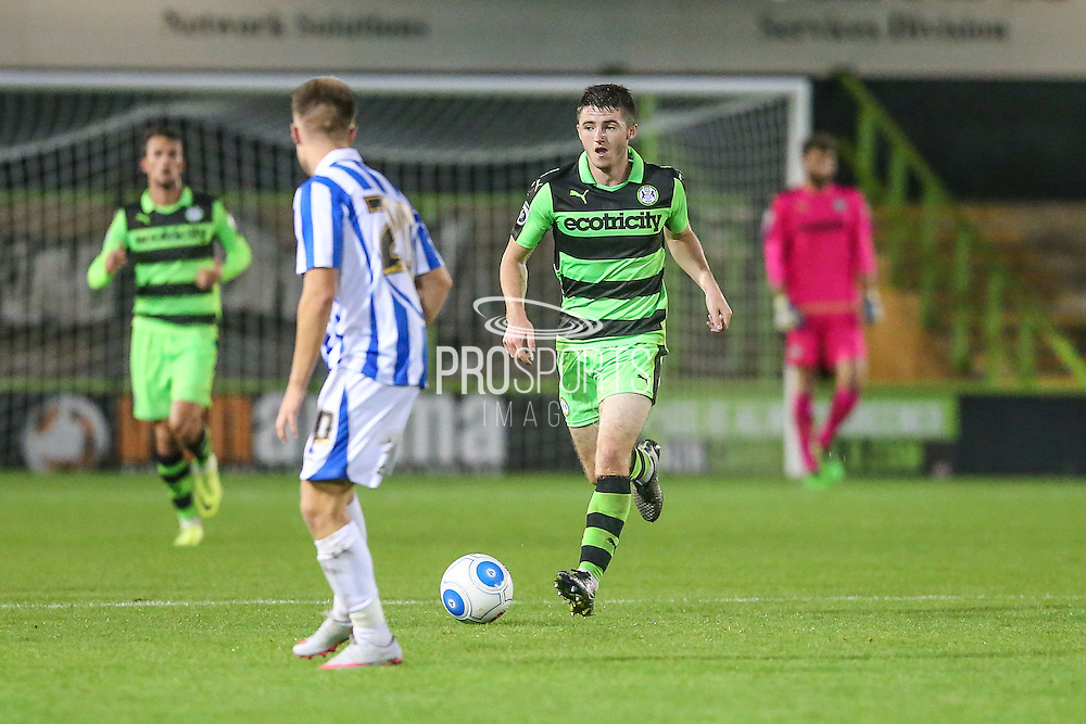 Forest Green Rovers Louis McGrory (22) runs forward during the Gloucestershire Senior Cup match between Forest Green Rovers and Cheltenham Town at the New Lawn, Forest Green, United Kingdom on 20 September 2016. Photo by Shane Healey.