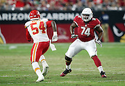 Arizona Cardinals offensive tackle D.J. Humphries (74) blocks Kansas City Chiefs linebacker Dezman Moses (54) during the 2015 NFL preseason football game against the Kansas City Chiefs on Saturday, Aug. 15, 2015 in Glendale, Ariz. The Chiefs won the game 34-19. (©Paul Anthony Spinelli)