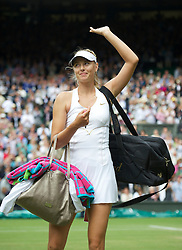 LONDON, ENGLAND - Thursday, June 30, 2011: Maria Sharapova (RUS) waves to the crowd after winning the Ladies' Singles Semi-Final match on day ten of the Wimbledon Lawn Tennis Championships at the All England Lawn Tennis and Croquet Club. (Pic by David Rawcliffe/Propaganda)
