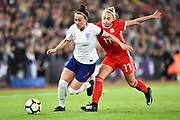Lucia Bronze (2) of England on the attack with Charlotte Estcourt (17) of Wales battling for possession during the FIFA Women's World Cup UEFA Qualifier match between England Ladies and Wales Women at the St Mary's Stadium, Southampton, England on 6 April 2018. Picture by Graham Hunt.