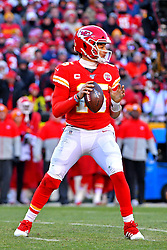 Jan 19, 2020; Kansas City, Missouri, USA; Kansas City Chiefs quarterback Patrick Mahomes (15) drops back to pass during the first half against the Tennessee Titans in the AFC Championship Game at Arrowhead Stadium. Mandatory Credit: Denny Medley-USA TODAY Sports