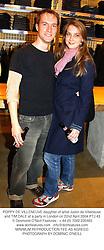 POPPY DE VILLENEUVE daughter of artist Justin de Villeneuve and TIM DALE at a party in London on 22nd April 2004.PTJ 43