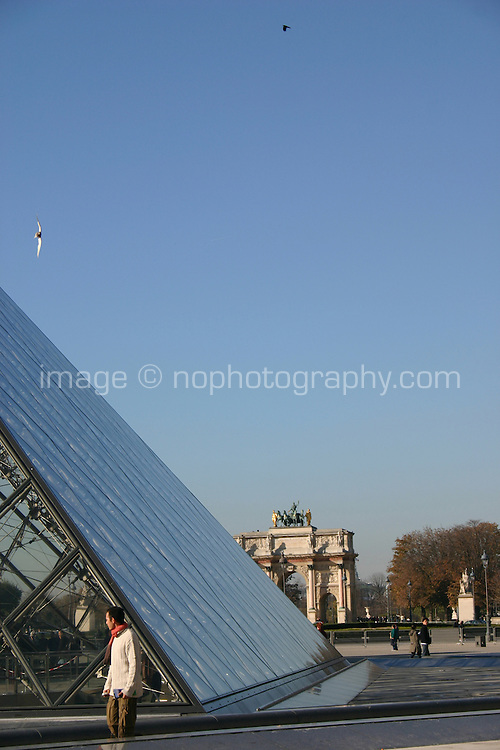 Glass pyramid at the Louvre, Paris, France. Tuileries gardens in background.<br />