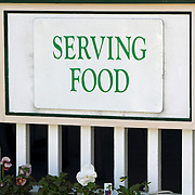 A sign at a restaurant in Provincetown, Cape Cod, Massachusetts, USA. The town at the tip of Cape Cod has a fun reputation and this sign is indicative of the humor found.