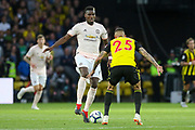 Manchester United Midfielder Paul Pogba takes on Watford defender Jose Holebas (25) during the Premier League match between Watford and Manchester United at Vicarage Road, Watford, England on 15 September 2018.
