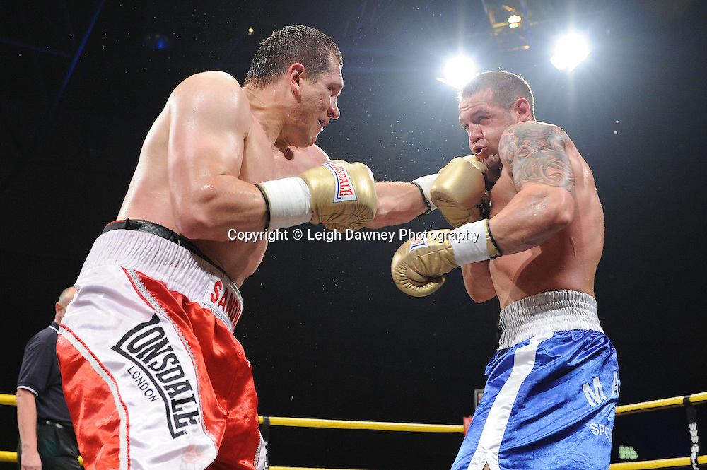 Konstantin Airich (red/white shorts) defeats Lucian Bot in Quarter Final 4 at Prizefighter International on Saturday 7th May 2011. Prizefighter / Matchroom. Photo credit © Leigh Dawney. Alexandra Palace, London.
