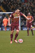 Bradford City Defender, Anthony McMahon on the ball in mnidfield during the The FA Cup third round match between Bury and Bradford City at Gigg Lane, Bury, England on 9 January 2016. Photo by Mark Pollitt.