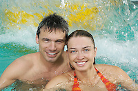 Young couple in swimming pool portrait