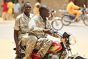Two soldiers ride a motorcycle in N'Djamena, Chad on Tuesday June 8, 2010.