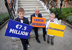 Repro Free: 17/09/2012. Oran (8) and Fionn O'Hagan (5) from Dun Laoghaire are pictured helping Prof. John Fitzpatrick, Head of Research at the Irish Cancer Society today announce that the Society has taken a major step forward to deliver its vision for cancer research in Ireland, by allocating ?7.5 million in funding to establish a Collaborative Cancer Research Centre in Ireland. This equates to ?1.5 million in funding being allocated per year, for up to five years. Pic Andres Poveda.
