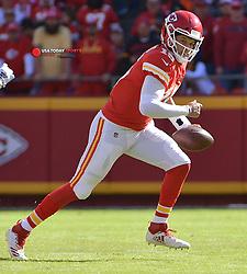 Oct 28, 2018; Kansas City, MO, USA; Kansas City Chiefs quarterback Patrick Mahomes (15) scrambles out of the pocket during the first half against the Denver Broncos at Arrowhead Stadium. Mandatory Credit: Denny Medley-USA TODAY Sports