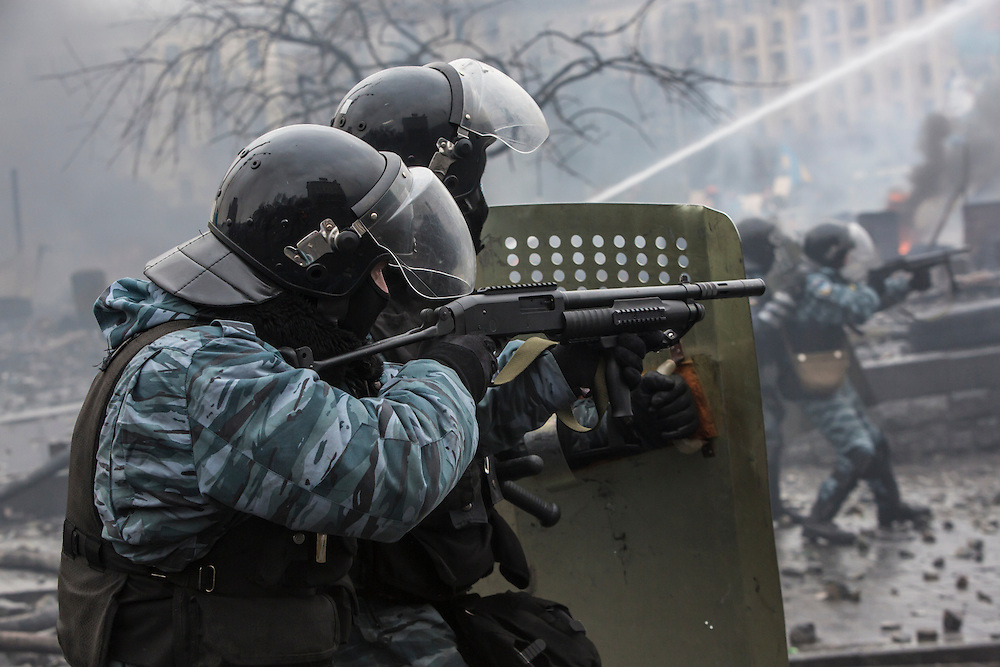 KIEV, UKRAINE - FEBRUARY 19: Berkut riot police shoot rubber bullets toward anti-government protesters on Independence Square on February 19, 2014 in Kiev, Ukraine. After several weeks of calm, violence has again flared between anti-government protesters and police as the Ukrainian parliament is meant to take up the question of whether to revert to the country's 2004 constitution. (Photo by Brendan Hoffman/Getty Images) *** Local Caption ***
