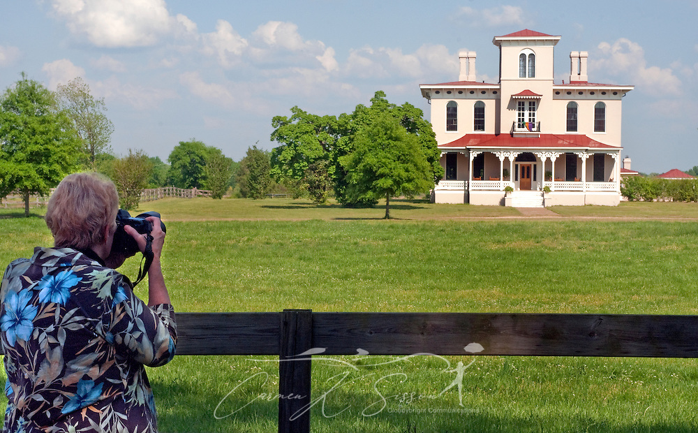 Photographer Judy Howle takes a picture of Rosedale Mansion in Columbus, Miss. April 17, 2010. The 1856 Italianate home was among nearly two dozen on tour during Columbus' annual Spring Pilgrimage. (Photo by Carmen K. Sisson/Cloudybright)