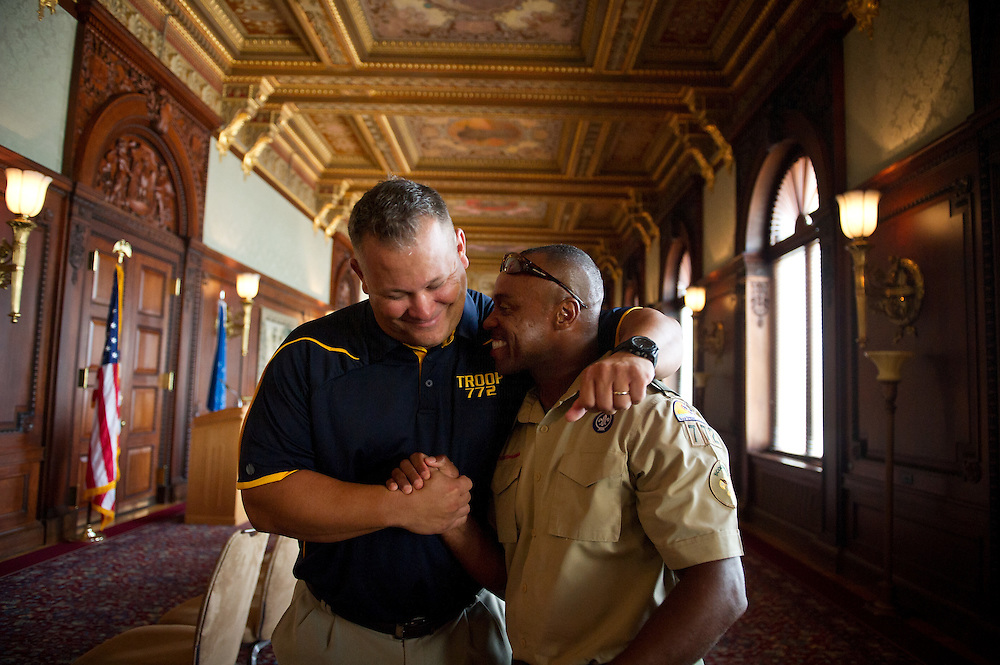 Boy Scout Troop 772 Executive Officer Scott Van Duzer (left) and Scoutmaster Rusty Hines celebrate with each other after an awards ceremony for the scouts and their supporters at the Library of Congress Jefferson Building in Washington, D.C. on July 22, 2014. The scouts toured the White House the next day, and met civil rights leader and Congressman John Lewis. (XAVIER MASCAREÑAS/TREASURE COAST NEWSPAPERS)