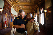 Boy Scout Troop 772 Executive Officer Scott Van Duzer (left) and Scoutmaster Rusty Hines celebrate with each other after an awards ceremony for the scouts and their supporters at the Library of Congress Jefferson Building in Washington, D.C. on July 22, 2014. The scouts toured the White House the next day, and meet civil rights leader and Congressman John Lewis. (XAVIER MASCAREÑAS/TREASURE COAST NEWSPAPERS)
