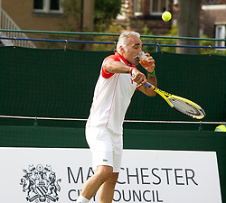 MANCHESTER, ENGLAND: Mansour Bahrami (IRN) drinks a spectator's pint of larger on Day 3 of the Manchester Masters Tennis Tournament at the Northern Tennis Club. (Pic by David Tickle/Propaganda)
