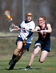 Virginia Cavaliers M Ashley McCulloch (16) is challenged by Syracuse Orange D Shannon Brushe (17).  The #2 ranked Virginia Cavaliers women's lacrosse team defeated the #4 ranked Syracuse Orange 13-8 at the University of Virginia's Klockner Stadium in Charlottesville, VA on March 1, 2008.