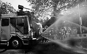 Bangladeshi police use a water canon to disperse activists during a strike to protest the construction of a coal-fired power plant in Dhaka on January 26, 2016. Clashes erupted in Bangladesh's capital January 26 as police fired tear gas at hundreds of campaigners protesting against a massive coal-fired power plant they say will destroy the world's largest mangrove forest. Witnesses said Shahbagh Square, Dhaka's main protest venue, turned into a battleground as police used water cannon and fired tear gas and rubber bullets at hundreds of left-wing and environmental protesters. © Monirul Alam