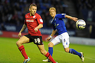 Cardiff city's Craig Bellamy (39) is shadowed by Leicester's Zak Whitbread. NPower championship, Leicester city v Cardiff city at the King Power stadium in Leicester on Saturday 22nd Dec 2012. pic by Andrew Orchard, Andrew Orchard sports photography,
