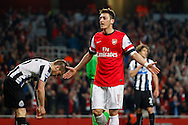 Mesut Ozil of Arsenal celebrates scoring his team's second goal during the Barclays Premier League match at the Emirates Stadium, London<br /> Picture by David Horn/Focus Images Ltd +44 7545 970036<br /> 28/04/2014