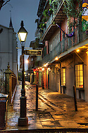Dawn on Pirate's Alley in New Orleans' French Quarter.  Creole townhouses line the right side of the alley, paved with cobblestones by 1831, with the 1789 Spanish Colonial St. Louis Cathedral to the left.
