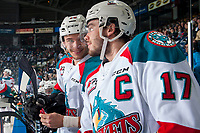 KELOWNA, CANADA - APRIL 26: Rodney Southam #17 and Carsen Twarynski #18 of the Kelowna Rockets stand on the bench against the Seattle Thunderbirds on April 26, 2017 at Prospera Place in Kelowna, British Columbia, Canada.  (Photo by Marissa Baecker/Shoot the Breeze)  *** Local Caption ***