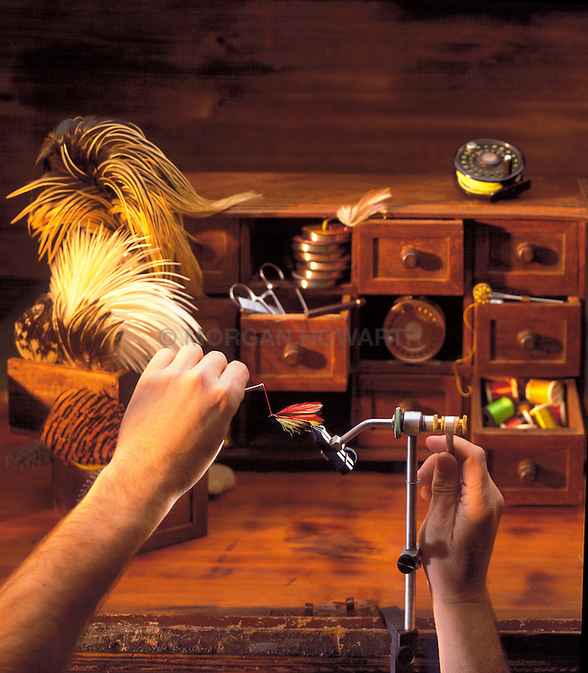 Fishing fly tying bench with fly tying supplies and tools