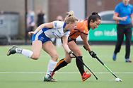 Eindhoven - Oranje Rood - Kampong  Dames, Hoofdklasse Hockey Heren, Seizoen 2017-2018, 15-04-2018, Oranje Rood - Kampong 3-1,  Marieke van der Vis (Kampong) en Hazuki Nagai (Oranje-Rood)<br /> <br /> (c) Willem Vernes Fotografie