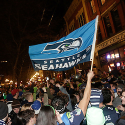 Seattle Seahawks fans take to the streets after their team wins Super Bowl XLVIII in Seattle, Washington February 2, 2014. The Seahawks beat the Denver Broncos 43-8 for their first NFL championship Sunday in East Rutherford, New Jersey.  REUTERS/Jason Redmond  (UNITED STATES)