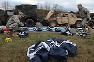 Xavier Mascareñas/Newsday; Army National Guard troops prepare bags of emergency supplies before heading out from the Camp Smith training site to assist Con Edison. (Nov. 3, 2012)