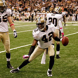 2009 October 04: New Orleans Saints safety Darren Sharper (42) celebrates after his second interception of the game during a 24-10 win by the New Orleans Saints over the New York Jets at the Louisiana Superdome in New Orleans, Louisiana.
