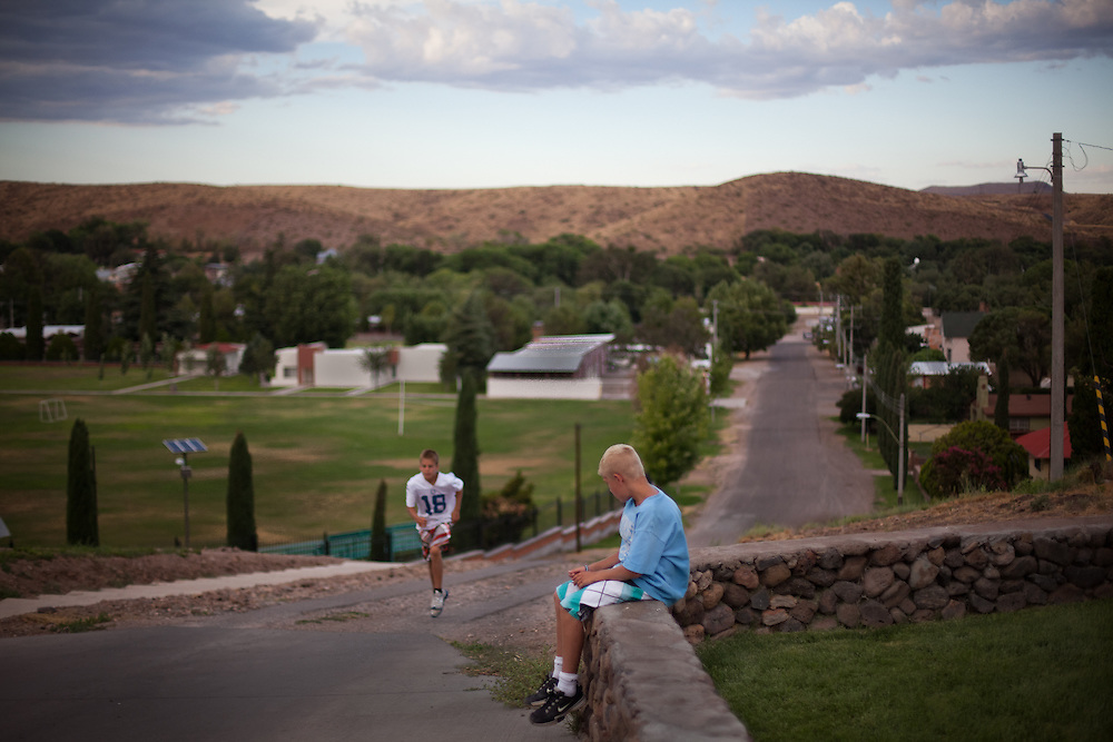 From left,  Gunner, 11, runs up a hill as his brother Cade, 9, takes a rest from training in Colonia Juarez, Mexico in July 2011. United States Presidential candidate Mitt Romney's family migrated to Mexico over 100 years ago after being granted asylum from Mexican President Porfirio Diaz after they had been pursued by the U.S. authorities for polygamy. ..(Romney is currently running for the Republican nomination.)
