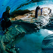 Photographers explore the underside of the Viedma Glacier in Los Glacieres National Park near El Chalten, Argentina.