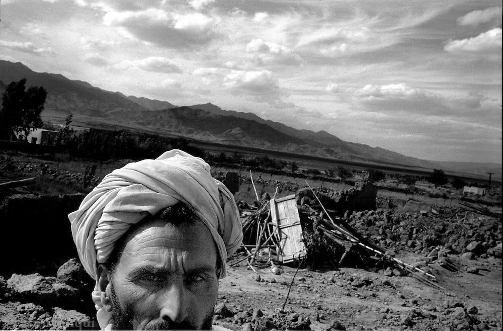 kalooshah, south waziristan, april 2004: mir abbas khan sits outside the remains of his family home, destroyed by pakistan army bulldozers.  the army has destroyed dozens of homes in this area of people it claims were harboring al qaeda fighters and collaborators.  many innocent civilians have lost their homes, belongings and means of livelihood as a consequence.<br />