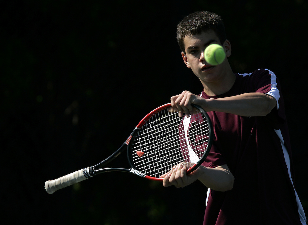 Scarsdale's David Goldberg, shown here swinging at the ball in frustration with the handle of his racket, and partner Jake Gorobetz played a doubles match against Commack's (Long Island) Bryan Roberts and Zach Dean during the boys varsity tennis state tournament at the USTA National Tennis Center in Flushing May 30, 2009. Goldberg and Gorobetz lost the match 6-3, 7-6, (8-6). ( Mike Roy / The Journal News )