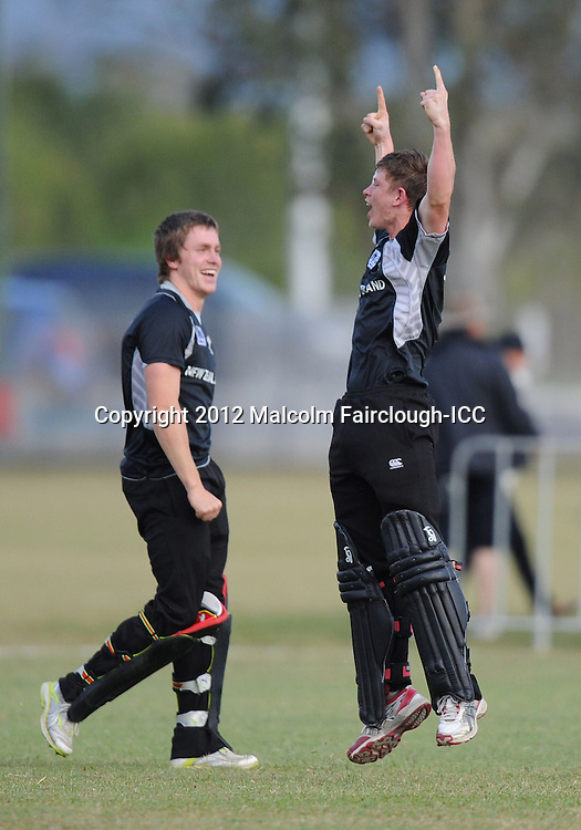 TOWNSVILLE, AUSTRALIA - AUGUST 20:   Cameron Fletcher of New Zealand raises his arms in celebration as Connor Neynens (L) looks on after New Zealand defeated the West Indies during the ICC U19 Cricket World Cup 2012 Quarter Final match between New Zealand and the West Indies at Endeavour Park on August 20, 2012 in Townsville, Australia.  (Photo by Malcolm Fairclough-ICC/Getty Images)