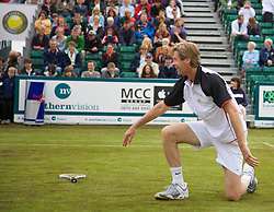 Liverpool, England - Saturday, June 16, 2007: Peter Fleming crashes to the floor on a slippery court on day five of the Liverpool International Tennis Tournament at Calderstones Park. For more information visit www.liverpooltennis.co.uk. (Pic by David Rawcliffe/Propaganda)