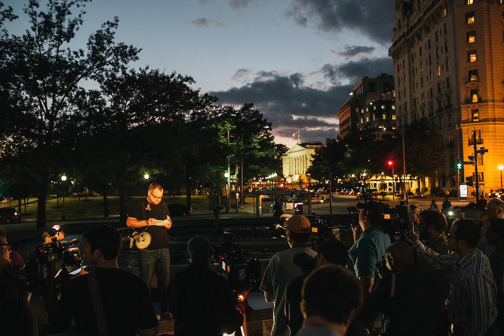 WASHINGTON, DC - SEPTEMBER 16:  Eddie Weingart, of Project End Gun Violence, speaks to members of the media during a candlelight vigil at Freedom Plaza in Washington, D.C. on Sept. 16, 2013. The vigil, during which Weingart called for stricter gun laws, was in remembrance of the more than 10 killed in a shooting at the Navy Yard earlier in the day.   (Photo by Greg Kahn/Getty Images)