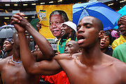 Mourners attend the official memorial service for Nelson Rolihlahla Mandela the FNB stadium in Soweto near Johannesburg. South Africa.<br />